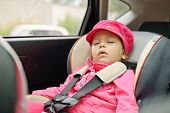 pic of seatbelt  - toddler girl is sleeping in car seat - JPG