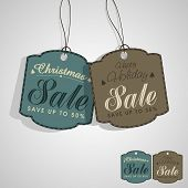 Sale tag or label on shiny grey background for Merry Christmas and other occasion celebrations.