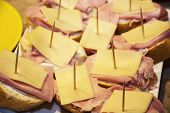 Tasty Canapes With Cheese, Ham And Butter