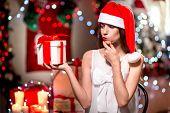 Young woman with present box on Christmas