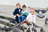 children Feeding Doves