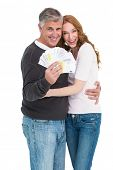 Casual couple showing their cash on white background