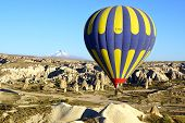Hot Air Balloon Flying Over With Erciyes Volcano.