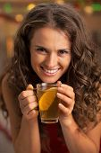 Portrait Of Happy Young Woman Drinking Tea