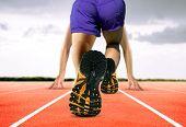 Man Feet On Running Track