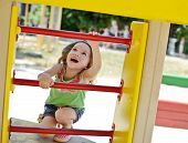 pic of playground  - happy toddler girl playing on the playground - JPG