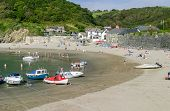 Tourists And Boats On The Sandy Beach Of Polkerris A Famous