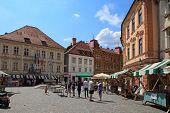Ljubljana, Slovenia - Circa July 2014: Tourists Wander Through The Old Town In Ljubljana, Slovenia.