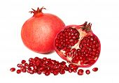 One Whole And A Half Pomegranates With Seeds (isolated)