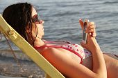 Beautiful Woman Lying On A Deckchair Near The Sea