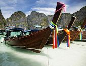 Adaman sea and wooden boat in Thailand - exotic beach holiday background