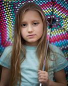 Young Girl With Long Hair Holding An Umbrella