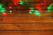 Christmas lights garland on wooden background