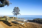 A beautiful picnic area overlooking the ocean in Santa Barbara, California at days end when the sun is setting.
