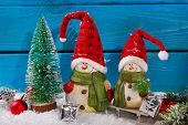 Christmas Decoration With Santa Figurines On Wooden Background