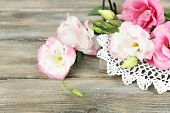 Beautiful eustoma flowers on wooden background
