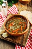 Delicious lentil soup on table close-up