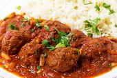 pic of pine nut  - Meatballs with pine nuts in a spicy tomato sauce - JPG