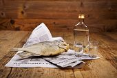 Russian snack . Vodka and dried fish