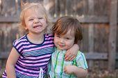 Caucasian Toddler Boy and Girl Smiling