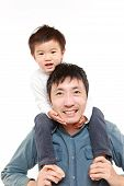 Japanese father giving his son piggy back