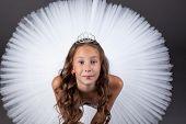 Top view of young ballerina looking at camera