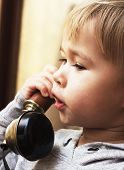 Child with a vintage telephone
