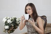 Brunette Girl. Drinking Coffee Tea
