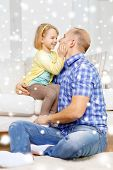 family, child and happiness concept - smiling father and daughter hugging at home