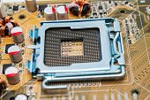 image of processor socket  - Empty CPU processor socket with pins on motherboard - JPG