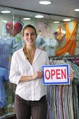 Retail Business: Store Owner With Open Sign