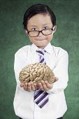 Little Businessman Holds Brain