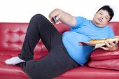 Man Eats Pizza While Watching Tv