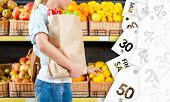 Girl hands bag with fresh vegetables choosing lemons at a good price