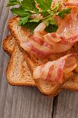 image of baps  - hot big sandwich, toast and bacon with parsley ** Note: Shallow depth of field - JPG