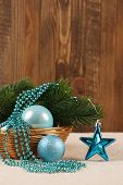 Christmas Tree Ornaments Balls, Beads And Spruce Branch In A Basket