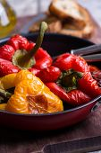 pic of pot roast  - Fresh roasted red and yellow peppers in pot selective focus - JPG