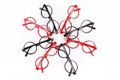 foto of bifocals  - Stack of red and black glasses isolated on white - JPG