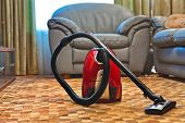Vacuum cleaner in room - technology housework