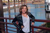 Teen Female Model Smiling Along Riverfront