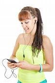 Young Woman Wearing Earphones Listening To Music Over Smart Phone