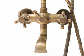 image of douche  - close up vintage brass douche isolated on white background - JPG