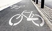 stock photo of bike path  - White painted bike path signs on asphalt - JPG