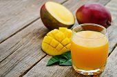 pic of mango  - mango juice and fresh mango on a dark wood background - JPG