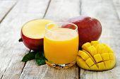 image of mango  - mango juice and fresh mango on a white wood background - JPG