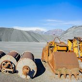 stock photo of ferrous metal  - Industrial Tools various and hill ferrous for metal foundry the background the Alps - JPG