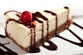 picture of cheesecake  - Cheesecake with Chocolate Sauce and Cherries - JPG