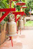 Постер, плакат: Buddhist bells in Wat Phan Tao Chiang Mai Thailand