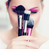 image of face-powder  - The makeup artist with bright pink make - JPG