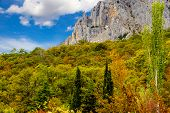 stock photo of mountain chain  - The rocky mountain is in the Crimean autumn - JPG